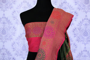 This astonishingly beautiful green embroidered muga banarsi silk saree looks effortlessly charming for weddings and events. Style this designer half-half silk sari with a red zari embroidered blouse. Shop designer silk sarees, printed saris, ikkat sarees online or visit Pure Elegance store in USA. -blouse pallu