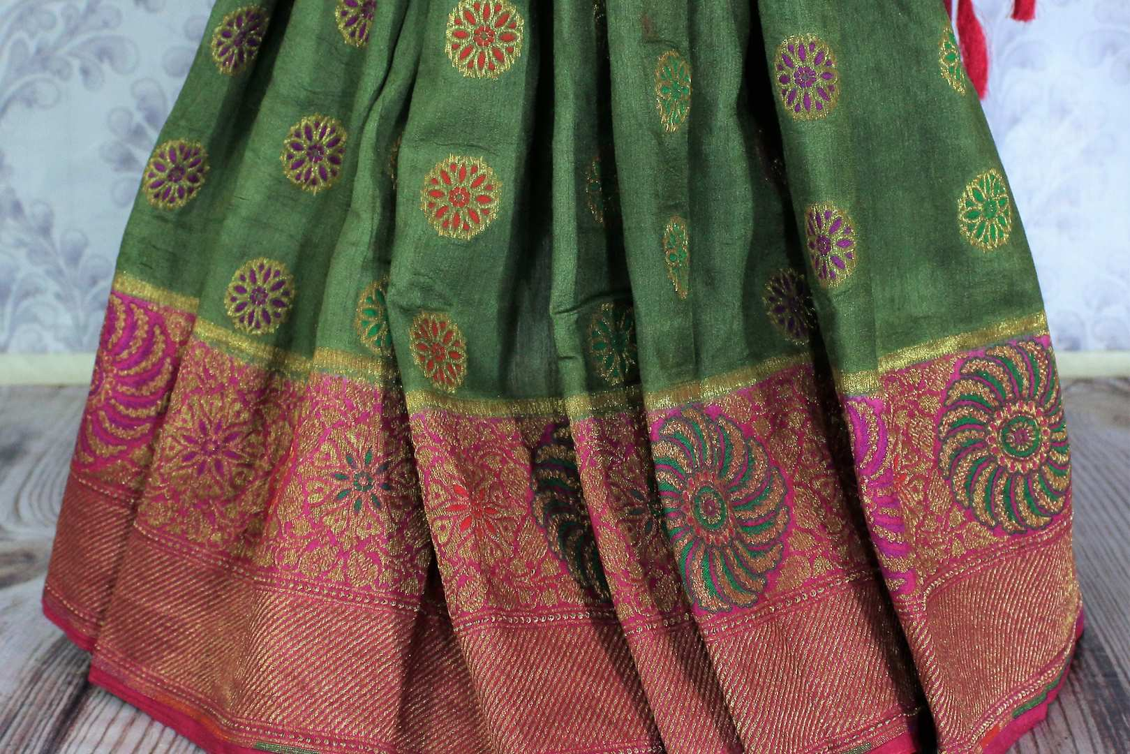 This astonishingly beautiful green embroidered muga banarsi silk saree looks effortlessly charming for weddings and events. Style this designer half-half silk sari with a red zari embroidered blouse. Shop designer silk sarees, printed saris, ikkat sarees online or visit Pure Elegance store in USA. -pleats