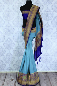 Dress up like a chic in this blue half-half designer muga banarsi silk saree. Complemented with a royal blue zari embroidered blouse and a heavily woven pallu, you will look no less than an Indian traditional lady. Shop designer sarees, printed saress, ikkat saris online or visit Pure Elegance store, USA.-full view