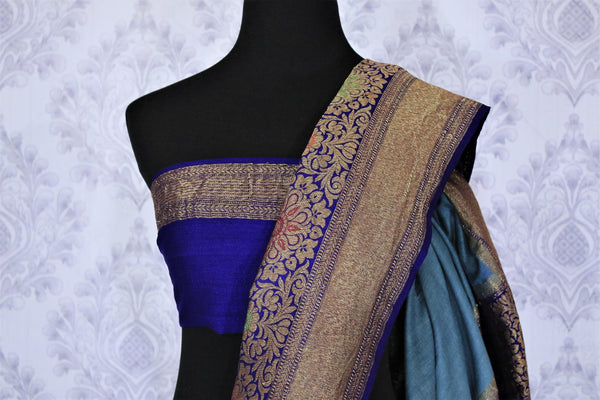 Dress up like a chic in this grey half-half designer muga banarsi silk saree. Complemented with a royal blue zari embroidered blouse and a heavily woven pallu, you will look no less than an Indian traditional lady. Shop designer sarees, printed saress, ikkat saris online or visit Pure Elegance store, USA.-blouse pallu