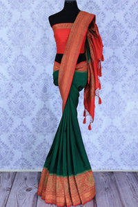 The ever-graceful green with red zari embroidered muga banarsi silk saree is a women's must-have. The traditional colors flowing together with the gorgeous blend of zari artwork. Take this stunner to parties, gala events and weddings. Shop this designer sari, printed sarees online or visit Pure Elegance store in USA.-full view