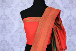 The ever-graceful green with red zari embroidered muga banarsi silk saree is a women's must-have. The traditional colors flowing together with the gorgeous blend of zari artwork. Take this stunner to parties, gala events and weddings. Shop this designer sari, printed sarees online or visit Pure Elegance store in USA.-blouse pallu