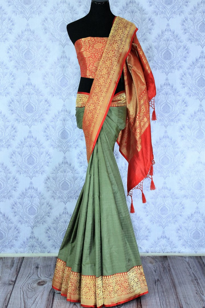 Exude femininity as you dress up in this designer green embroidered muga silk banarsi silk saree. Style it with a deep red zari silk woven blouse complemented with a zari pallu. Take this beauty to weddings, parties and fancy events. Shop designer silk sarees, ikkat sarees online or visit Pure Elegance store, USA. -full view