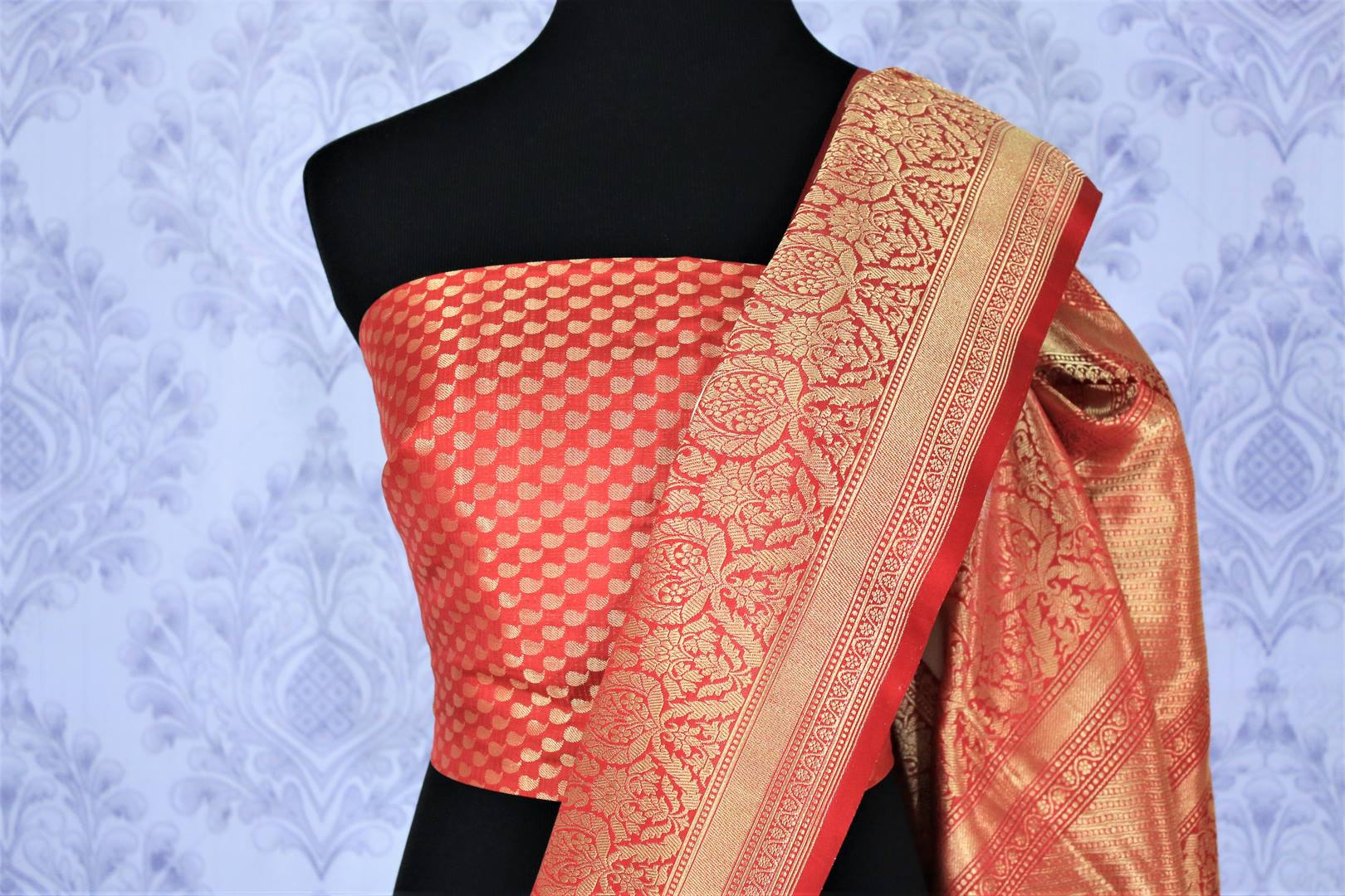 Embrace the divinity of a traditional Indian woman in this classic cream and red-hued muga banarsi silk saree. The contrasting red zari blouse accompanied with the rich red zari pallu looks spectacular. Shop designer silk saris, handloom sarees, ikkat saris online or visit Pure Elegance store in USA. -blouse pallu