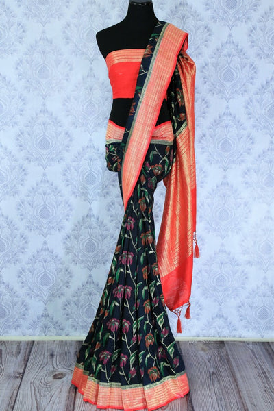 Cherish good times in this flamboyant yet suave black floral embroidered muga banarsi silk saree. This elegant designer sari featuring a bright red blouse and zari woven pallu looks absolutely gorgeous. Shop chanderi silk saris, banarsi silk saress, ikkat saris online or visit Pure Elegance store in USA. -full view