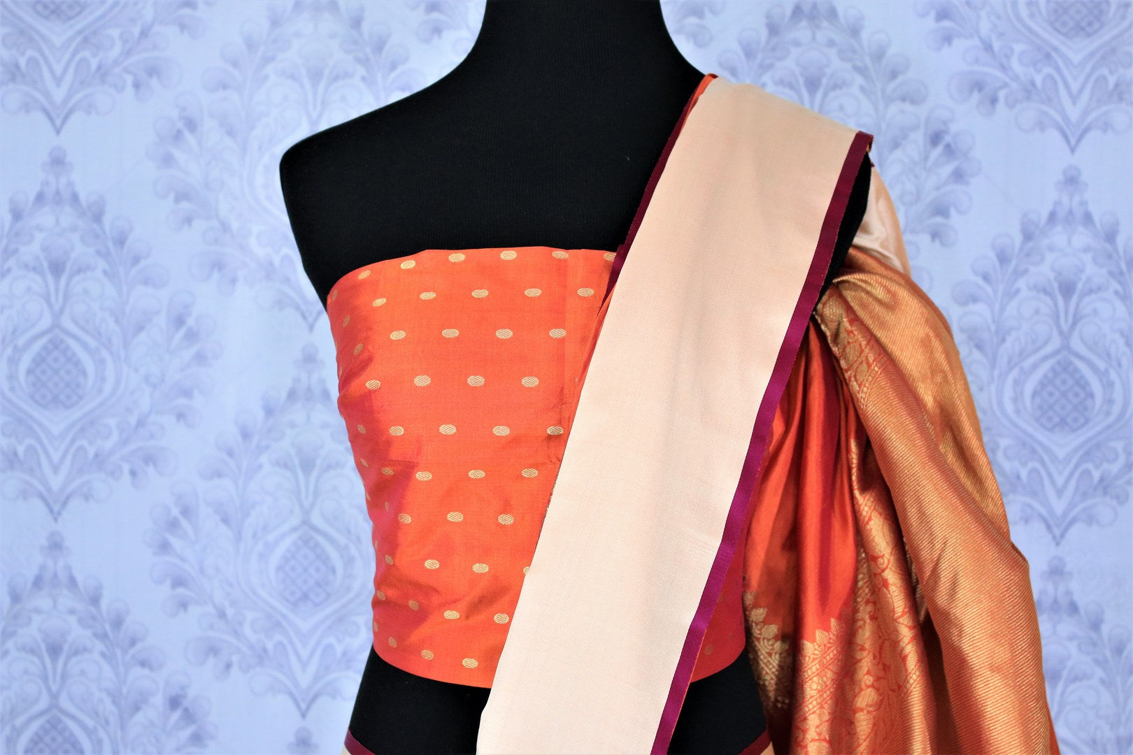 This plush yet royal orange traditional muga banarsi silk saree comes with a buta work orange designer blouse. The heavily woven pallu complemented with the zari detailing is crafted to perfection. Shop chanderi silk sarees, banarsi silk saris, ikkat sarees online or visit Pure Elegance store in USA. -blouse pallu