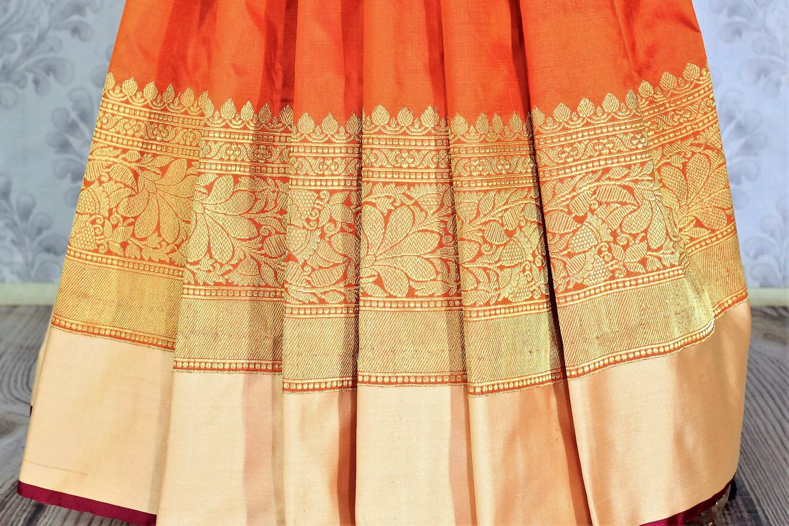 This plush yet royal orange traditional muga banarsi silk saree comes with a buta work orange designer blouse. The heavily woven pallu complemented with the zari detailing is crafted to perfection. Shop chanderi silk sarees, banarsi silk saris, ikkat sarees online or visit Pure Elegance store in USA. -pleats