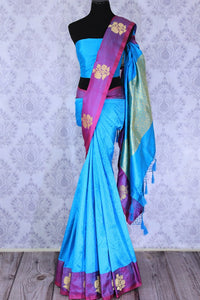 Dive into the elegance of this vibrant blue colored floral muga banarsi silk sari. It comes with a gorgeous designer purple woven border and pallu to create a pretty color block. It comes with a blue blouse. Shop banarsi silk sari, ikkat saris, printed sarees online or visit Pure Elegance store, USA. -full view