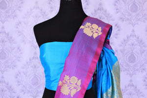 Dive into the elegance of this vibrant blue colored floral muga banarsi silk sari. It comes with a gorgeous designer purple woven border and pallu to create a pretty color block. It comes with a blue blouse. Shop banarsi silk sari, ikkat saris, printed sarees online or visit Pure Elegance store, USA. -blouse pallu