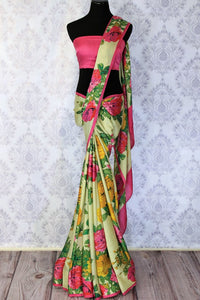 Feminine yet quirky, this designer beige floral printed crepe silk sari is your go-to for events and gatherings alike. The graceful drape is flattering and emanates soothing summer vibes. Shop such beautiful designer silk saris online or visit Pure Elegance store in USA.-full view