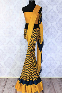 The invigorating mustard with blue striped crepe silk printed sari is a must-have in every woman's wardrobe. Exuding an air of elegance, pair this saree with mustard blouse to look effortlessly gorgeous. Shop such designer silk sarees, banarsi silk saris, ikkat sarees online or visit Pure Elegance store in USA. -full view