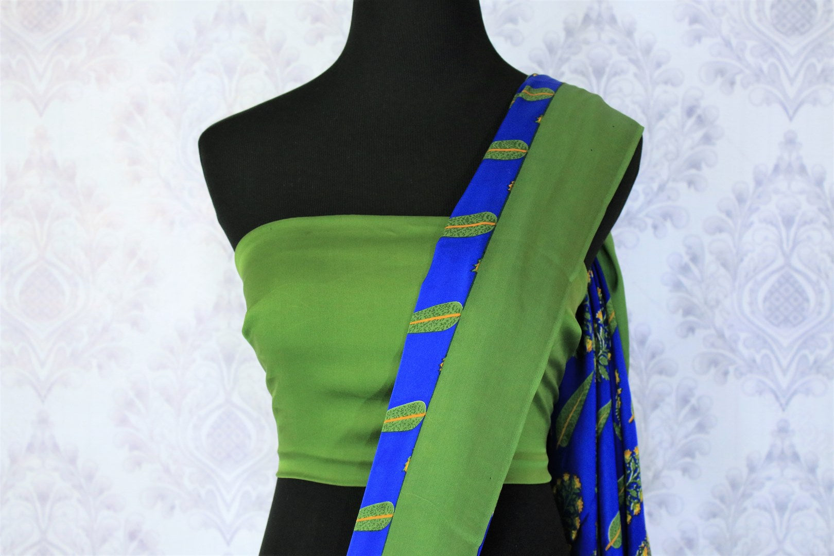 Strike a lasting impression in this handpainted blue floral crepe silk designer sari with stunning green border. The beautiful contrast with the green blouse looks dreamy. Shop unique and beautiful designer silk sarees, satin saris, kanjeevaram silk sarees online or visit Pure Elegance store in USA. -blouse pallu
