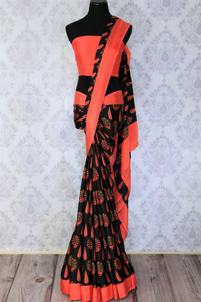 Gorge on the eternal classics with black with red floral handprinted designer crepe silk saree. It comes with a gorgeous red contrasting blouse and a printed pallu. Take this ensemble to events and special occasions. Shop handcrafted designer silk sarees, georgette saris online or visit Pure Elegance store in USA. -full view