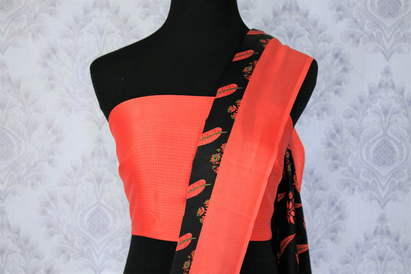 Gorge on the eternal classics with black with red floral handprinted designer crepe silk saree. It comes with a gorgeous red contrasting blouse and a printed pallu. Take this ensemble to events and special occasions. Shop handcrafted designer silk sarees, georgette saris online or visit Pure Elegance store in USA. -blouse pallu