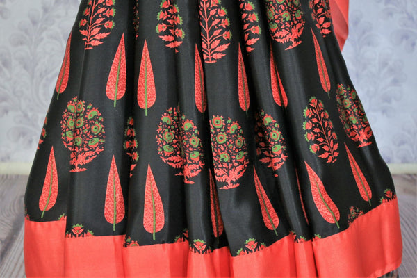 Gorge on the eternal classics with black with red floral handprinted designer crepe silk saree. It comes with a gorgeous red contrasting blouse and a printed pallu. Take this ensemble to events and special occasions. Shop handcrafted designer silk sarees, georgette saris online or visit Pure Elegance store in USA. -pleats