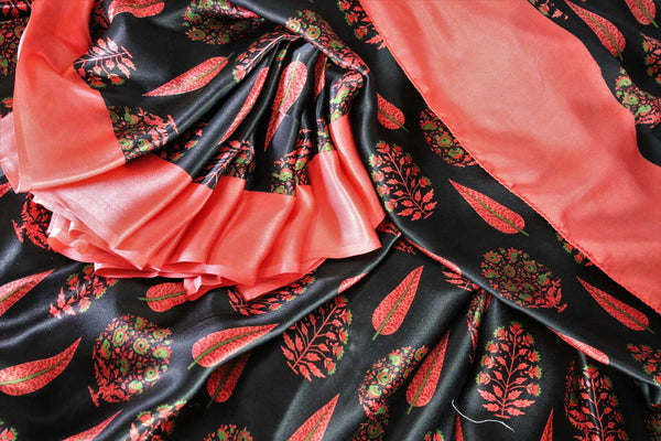 Gorge on the eternal classics with black with red floral handprinted designer crepe silk saree. It comes with a gorgeous red contrasting blouse and a printed pallu. Take this ensemble to events and special occasions. Shop handcrafted designer silk sarees, georgette saris online or visit Pure Elegance store in USA. -details