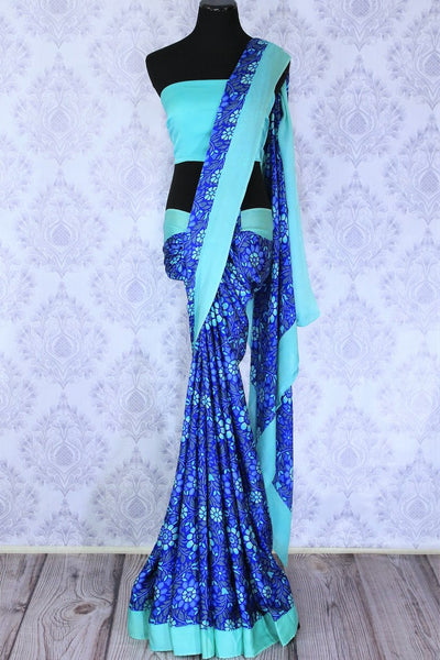 Dive into the summer mood with full bloom aqua blue floral printed saree. The light as feather crepe silk sari is complemented with the turquoise border to further enhance the beauty. Shop designer silk sarees, georgette saris, embroidered sarees online or visit Pure Elegance store in USA. -full view