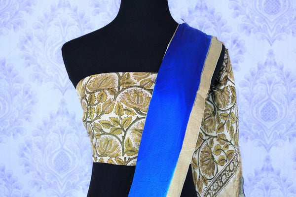 Melt them with the spring favourite blue shaded floral printed crepe silk saree. The gorgeous zari border complemented with the aesthetically pleasing hand printed white and yellow blouse. Shop kalamkari printed sarees, designer silk sarees online or visit Pure Elegance store in USA. -blouse pallu
