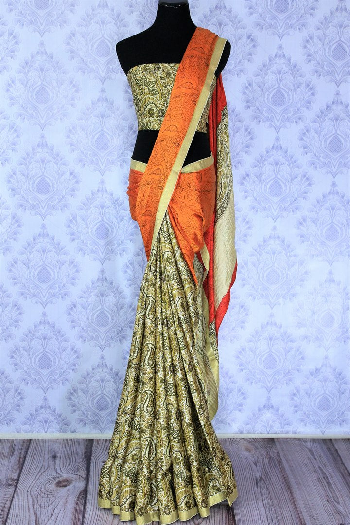 Style your workwear with orange and off-white hand printed crepe silk sari. The half half designer saree comes with an off-white printed blouse and glorious zari border. Take this to fancy art fairs and exhibitions. Shop handcrafted silk sarees, georgette sarees, kalakmari saris online or visit Pure Elegance store in USA. -full view
