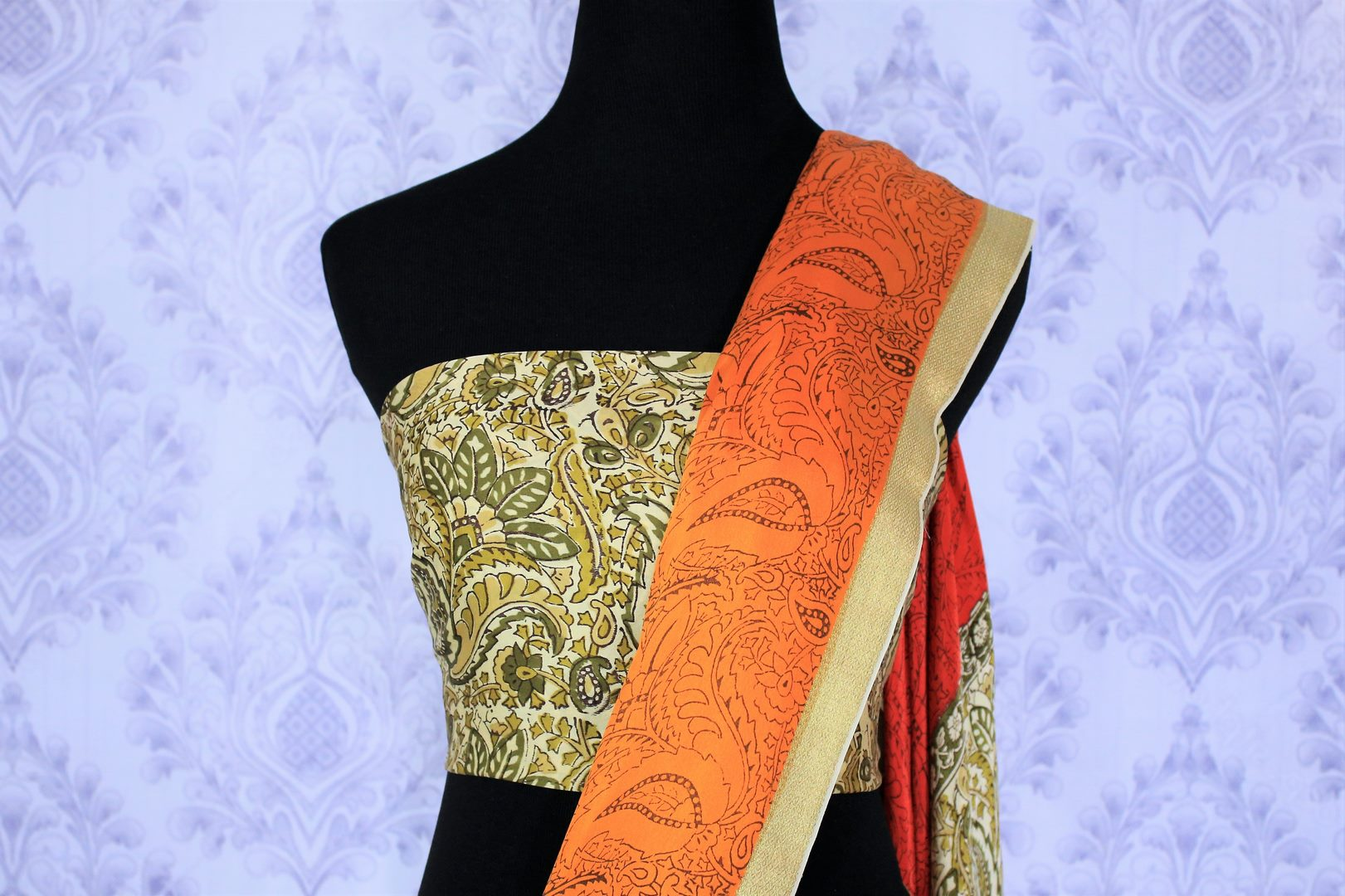 Style your workwear with orange and off-white hand printed crepe silk sari. The half half designer saree comes with an off-white printed blouse and glorious zari border. Take this to fancy art fairs and exhibitions. Shop handcrafted silk sarees, georgette sarees, kalakmari saris online or visit Pure Elegance store in USA. -blouse pallu