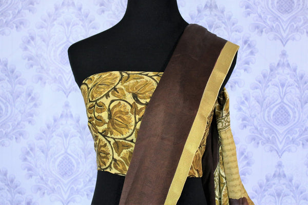 Add a pop of color to your outfit with this brown and pink half half designer crepe silk saree. The floral printed silk sari comes with a gorgeous cream printed blouse. The zari border at the bottom adds a flair of elegance. Shop handcrafted silk sarees, printed sarees online or visit Pure Elegance store in USA. -blouse pallu