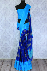 Feel the blues in this gorgeous half-half designer crepe silk blue colored sari. The stunning gold embroidered saree works well for both formal events and family gatherings. Style it with a light blue printed blouse to turn heads. Shop designer embroidered saris, silk saris online or visit Pure Elegance store in USA. -full view