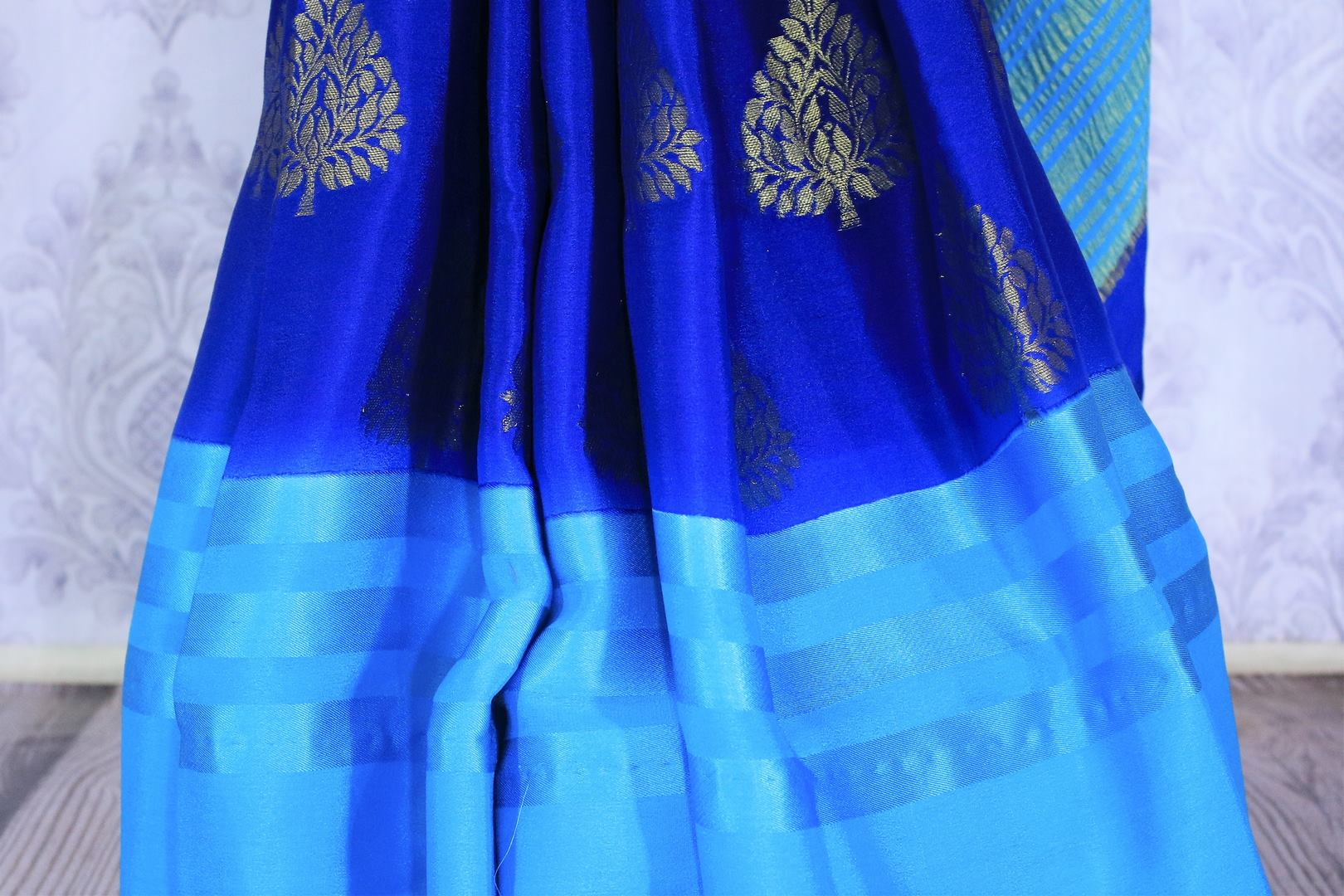 Feel the blues in this gorgeous half-half designer crepe silk blue colored sari. The stunning gold embroidered saree works well for both formal events and family gatherings. Style it with a light blue printed blouse to turn heads. Shop designer embroidered saris, silk saris online or visit Pure Elegance store in USA. -pleats