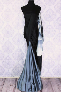 The artistic monochrome saree with a blend of black, white and grey color creates quite a spectacular sight. The effortlessly minimal half-half designer sari is paired with a black blouse to exude contemporary vibe.  Shop designer silk sarees, georgette saris online or visit Pure Elegance store in USA. -full view