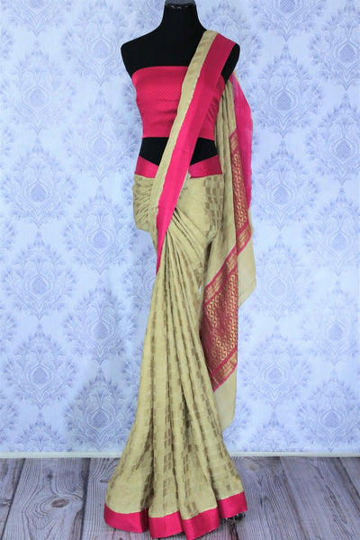 Indulge in the ethnic flavour with this exclusively designed beige embroidered crepe silk saree. It comes with a royal heavy zari pallu complemented with a bright pink blouse to add a pop of color. Shop such Indian designer silk sarees, printed saris, kanjeevaram silk saris online or visit Pure Elegance store in USA.-full view