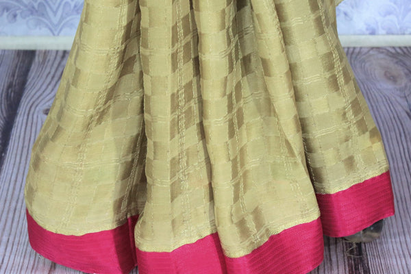 Indulge in the ethnic flavour with this exclusively designed beige embroidered crepe silk saree. It comes with a royal heavy zari pallu complemented with a bright pink blouse to add a pop of color. Shop such Indian designer silk sarees, printed saris, kanjeevaram silk saris online or visit Pure Elegance store in USA.-pleats