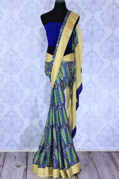 Bloom this summer in our exquisitely designed blue georgette handprinted saree. The easy breezy sari can be worn easily at work or events. It comes with a beige border and an electric blue contrasting blouse to look gorgeous. Shop such designer sarees, printed sarees, silk saris online or visit Pure Elegance store -full view