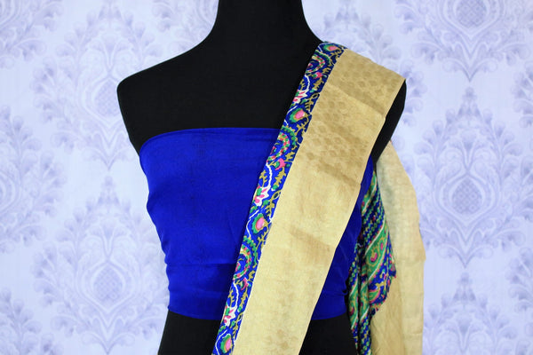 Bloom this summer in our exquisitely designed blue georgette handprinted saree. The easy breezy sari can be worn easily at work or events. It comes with a beige border and an electric blue contrasting blouse to look gorgeous. Shop such designer sarees, printed sarees, silk saris online or visit Pure Elegance store -blouse pallu