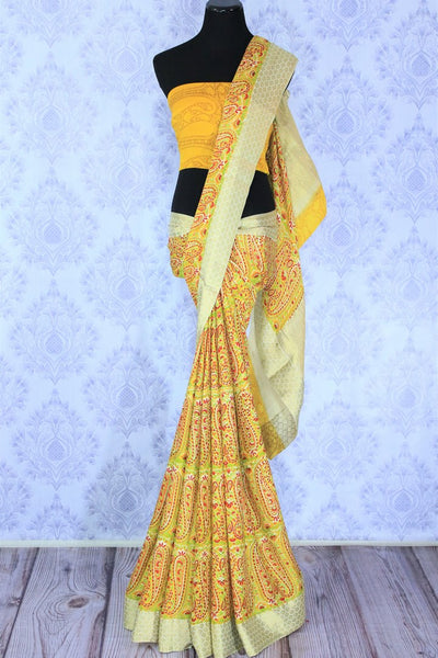 Inspired by the sunshine, this yellow printed georgette saree is perfect for the weekend brunches or work meetings. It comes with a rich gold embroidered pallu and yellow printed blouse to enhance its beauty. Shop such handcrafted designer silk saree, printed sari, ikkat sari online or visit Pure Elegance store in USA.-full view