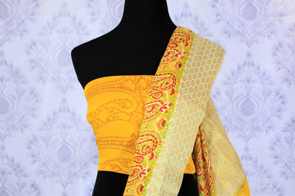 Inspired by the sunshine, this yellow printed georgette saree is perfect for the weekend brunches or work meetings. It comes with a rich gold embroidered pallu and yellow printed blouse to enhance its beauty. Shop such handcrafted designer silk saree, printed sari, ikkat sari online or visit Pure Elegance store in USA.-blouse pallu
