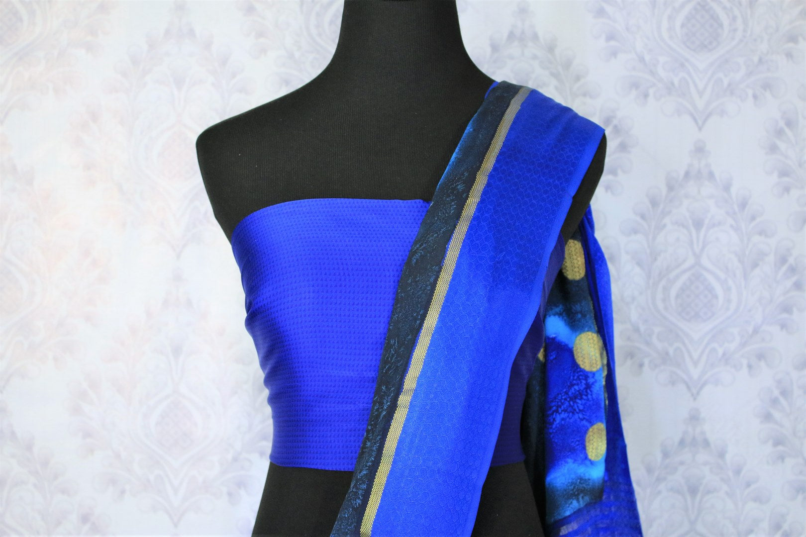Feel the summer bliss in this easy breezy blue-hued printed crepe silk sari with a rich zari pallu. This handcrafted silk saree comes with a royal blue blouse and a glorious blue broad border flowing throughout. Shop such designer silk sarees, ikkat saris, handloom sarees online or visit Pure Elegance store in USA. -blouse pallu