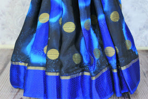 Feel the summer bliss in this easy breezy blue-hued printed crepe silk sari with a rich zari pallu. This handcrafted silk saree comes with a royal blue blouse and a glorious blue broad border flowing throughout. Shop such designer silk sarees, ikkat saris, handloom sarees online or visit Pure Elegance store in USA. -pleats