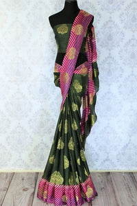 This solid green traditional saree with buta embroidery looks mesmerizing. The stunning pink leheriya border accompanied with a gorgeous green silk buta work embroidered blouse complemented with a heavy pallu looks heavenly. Shop the designer silk sarees, printed saris online or visit Pure Elegance store in USA. -full view