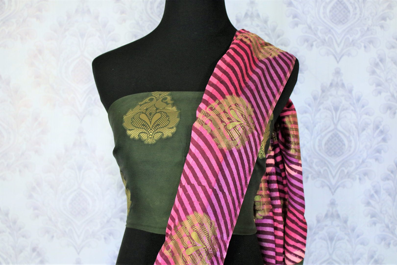 This solid green traditional saree with buta embroidery looks mesmerizing. The stunning pink leheriya border accompanied with a gorgeous green silk buta work embroidered blouse complemented with a heavy pallu looks heavenly. Shop the designer silk sarees, printed saris online or visit Pure Elegance store in USA. -blouse pallu
