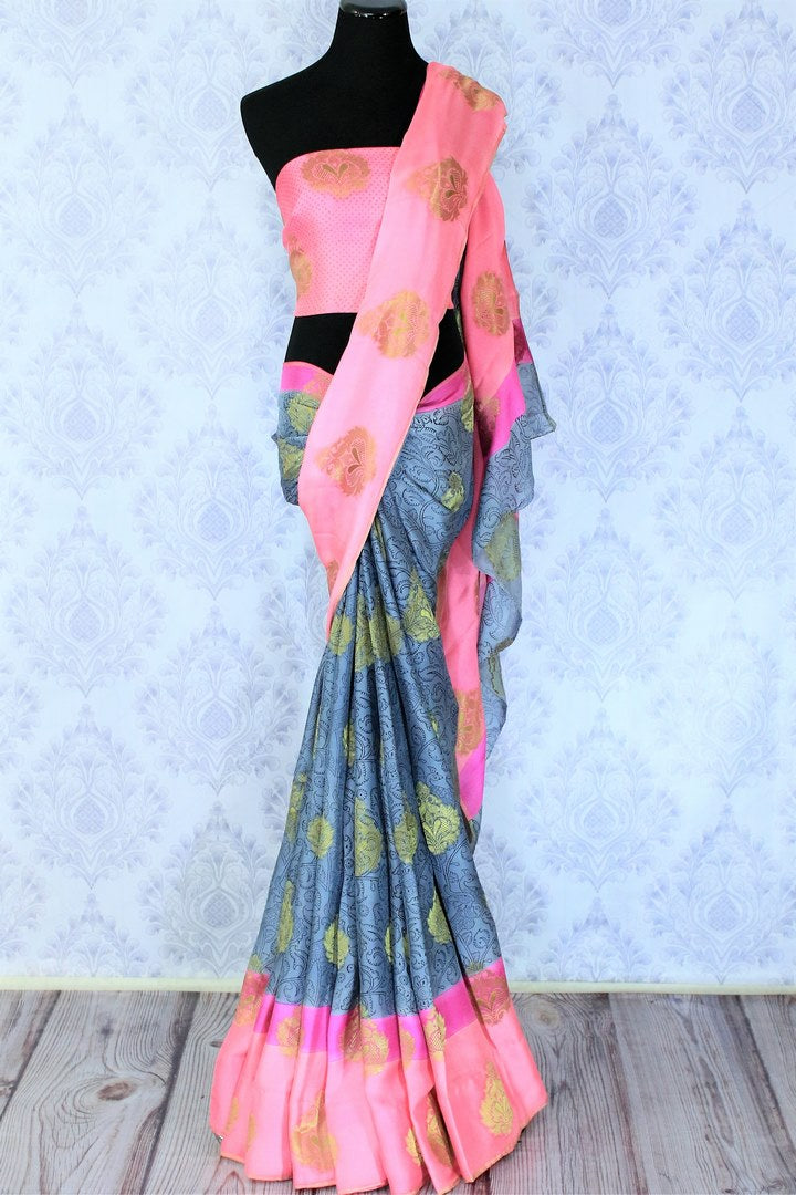 Savour the graceful grey floral printed half-half designer mulberry silk sari. The gorgeous zari detailing all over the saree with contrast rose pink combination in the blouse is striking enough to get drooling. Shop such festive traditional silk sarees online or visit Pure Elegance store in USA. -full view