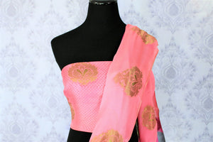 Savour the graceful grey floral printed half-half designer mulberry silk sari. The gorgeous zari detailing all over the saree with contrast rose pink combination in the blouse is striking enough to get drooling. Shop such festive traditional silk sarees online or visit Pure Elegance store in USA. -blouse pallu