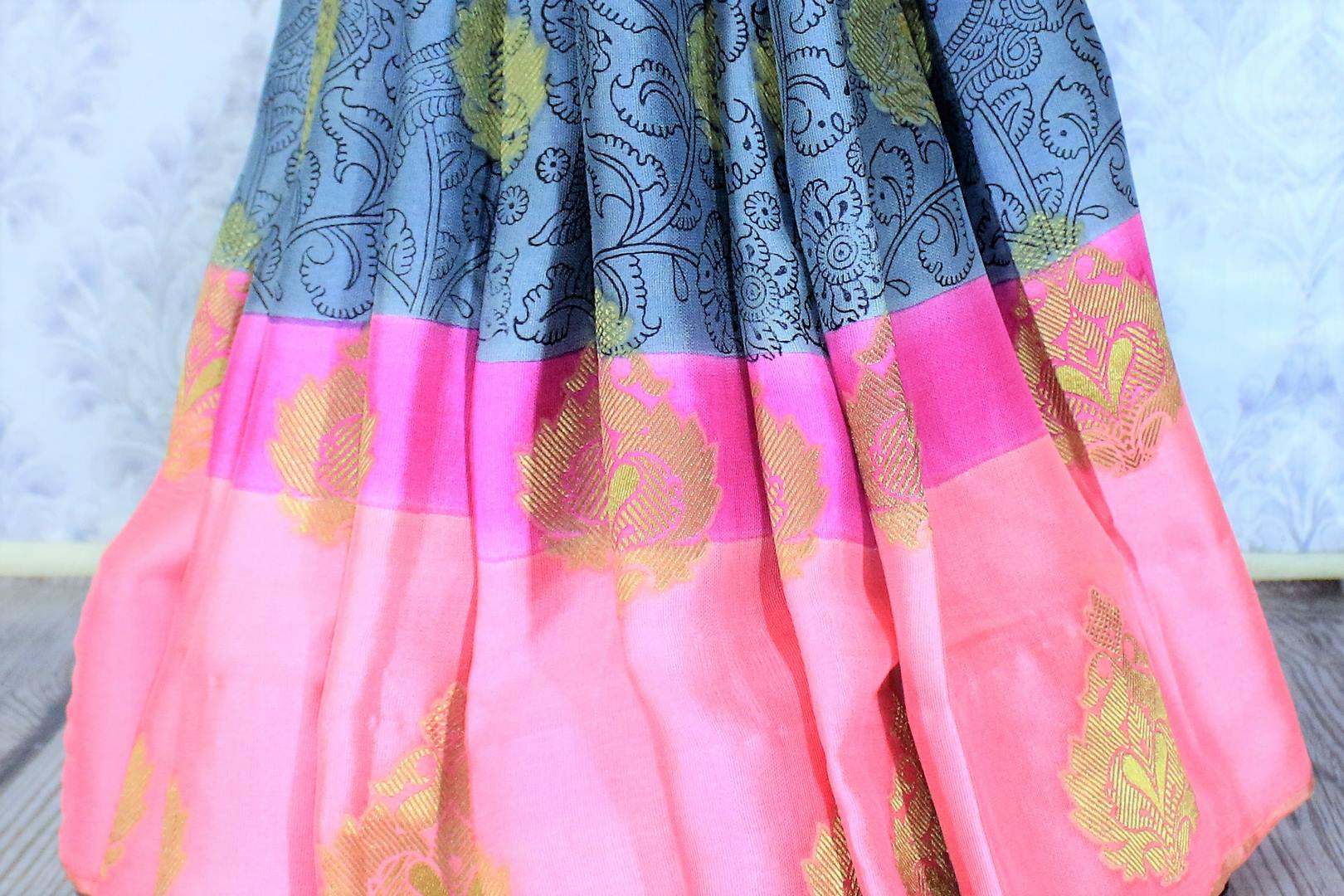Savour the graceful grey floral printed half-half designer mulberry silk sari. The gorgeous zari detailing all over the saree with contrast rose pink combination in the blouse is striking enough to get drooling. Shop such festive traditional silk sarees online or visit Pure Elegance store in USA. -pleats