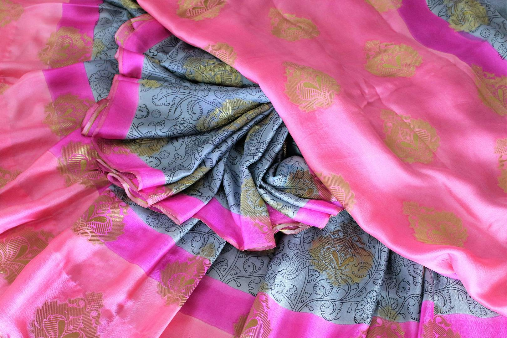 Savour the graceful grey floral printed half-half designer mulberry silk sari. The gorgeous zari detailing all over the saree with contrast rose pink combination in the blouse is striking enough to get drooling. Shop such festive traditional silk sarees online or visit Pure Elegance store in USA. -details