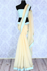 Slay in our exquisitely designed beige organza saree with meticulously embroidered border. Style this breath-taking sari with a turquoise blouse and steal the limelight. Shop handcrafted silk saris, printed saree, embroidered sari online or visit Pure Elegance store, USA.-full view