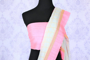 Grace in this summer staple blue organza saree with checkered pattern and a soft pink embroidered border flowing throughout. Style this suave sari with a blush pink blouse and slay effortlessly. Shop designer silk sari, chiffon saree, georgette saree online or visit Pure Elegance store, USA.-blouse pallu