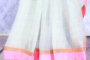 Grace in this summer staple blue organza saree with checkered pattern and a soft pink embroidered border flowing throughout. Style this suave sari with a blush pink blouse and slay effortlessly. Shop designer silk sari, chiffon saree, georgette saree online or visit Pure Elegance store, USA.-pleats