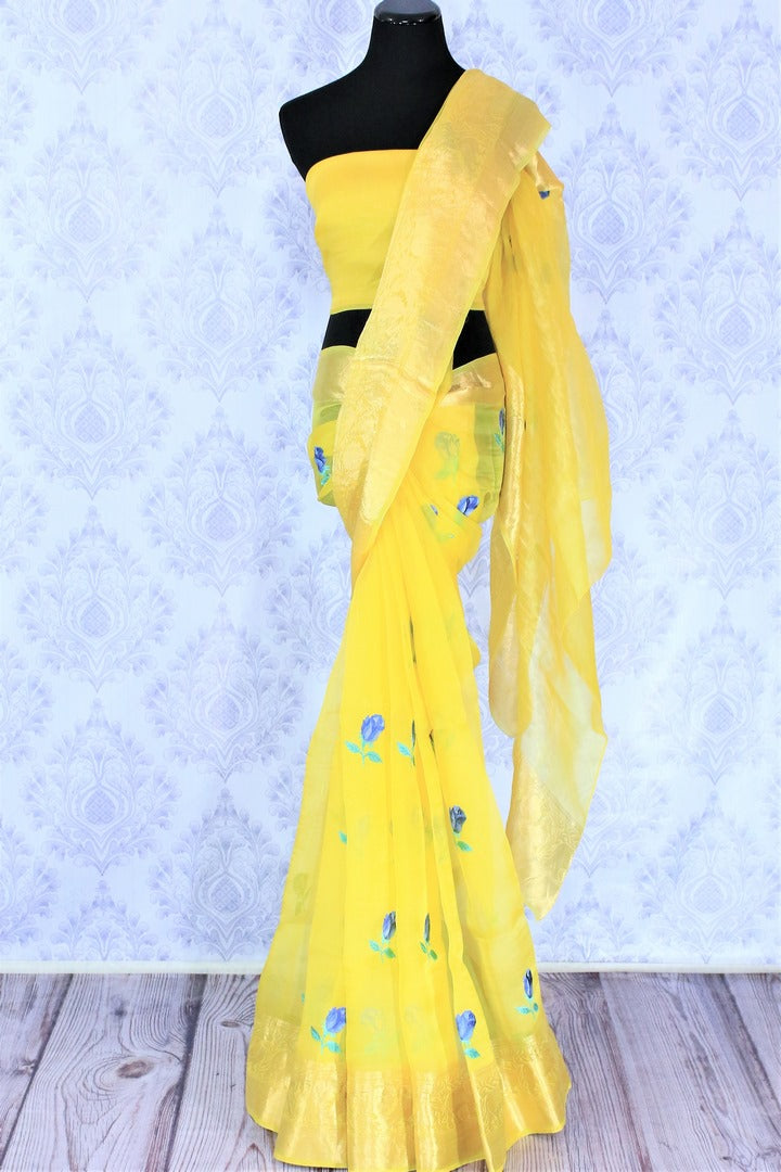 Leave them enchanted in this bright summer staple yellow organza floral embroidered saree. The breath-taking zari border enhances the beauty of this light as feather sari. Pair it with a yellow blouse and style it to work or formal events. Shop georgette sarees, chiffon sari online or visit Pure Elegance store, USA.-full view