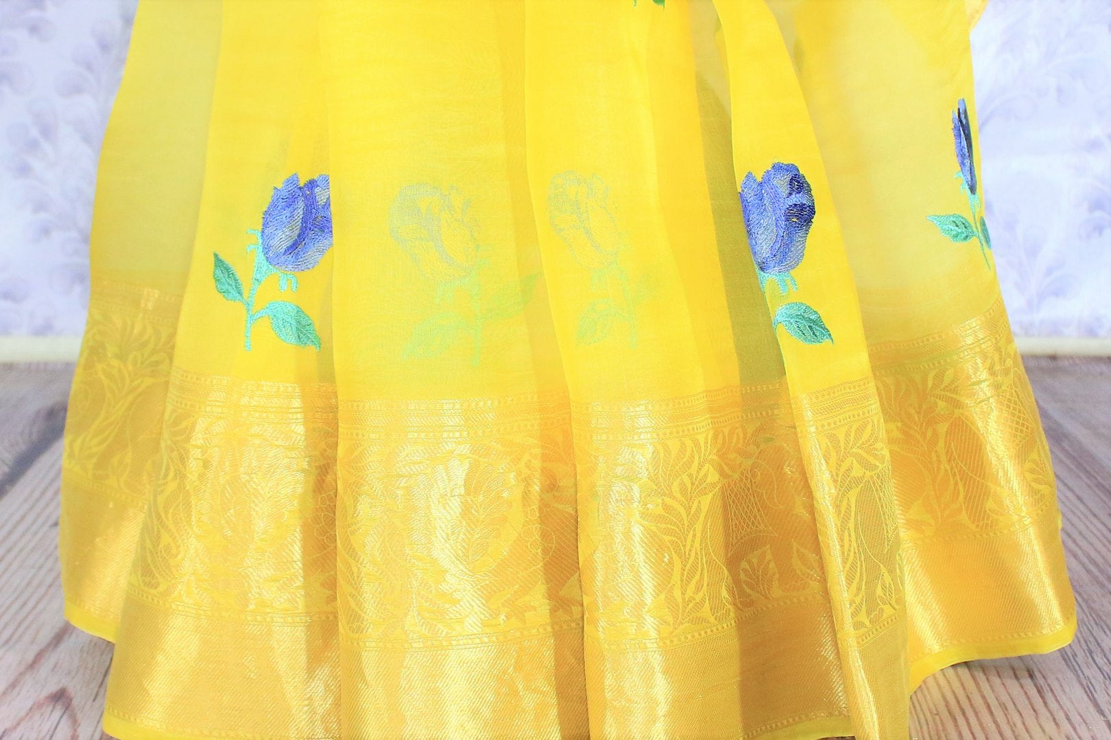 Leave them enchanted in this bright summer staple yellow organza floral embroidered saree. The breath-taking zari border enhances the beauty of this light as feather sari. Pair it with a yellow blouse and style it to work or formal events. Shop georgette sarees, chiffon sari online or visit Pure Elegance store, USA.-pleats