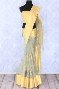 Envelop in this delicately crafted grey organza floral work saree with a beige border. Take this piece to parties and gatherings. It comes with a beige blouse. Shop handloom saris, silk sarees, designer sari online or visit Pure Elegance store, USA.-full view