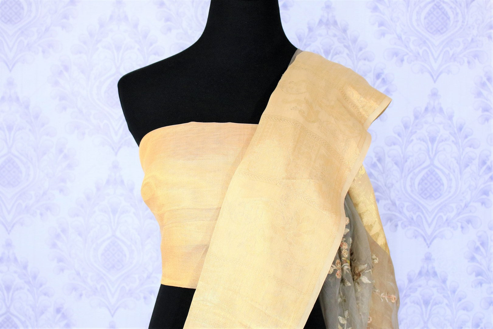 Envelop in this delicately crafted grey organza floral work saree with a beige border. Take this piece to parties and gatherings. It comes with a beige blouse. Shop handloom saris, silk sarees, designer sari online or visit Pure Elegance store, USA.-blouse pallu