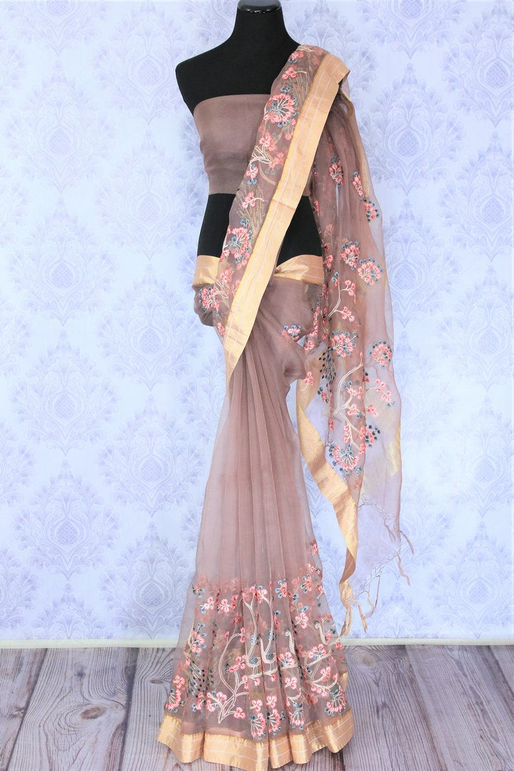Sashay like a princess in this pink organza floral work saree with a beige border. This pretty ensemble will bring you a heap of compliments, style it with a plain pink blouse and add oodles of grace. Shop handcrafted silk sari, georgette saree, chiffon sari online or visit Pure Elegance store, USA. -full view